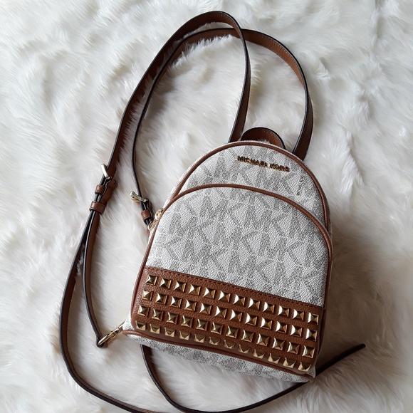 4603adfef816 Michael Kors Abbey Extra-Small Studded Backpack. M 5b8b37fdc617779ec2c42b18